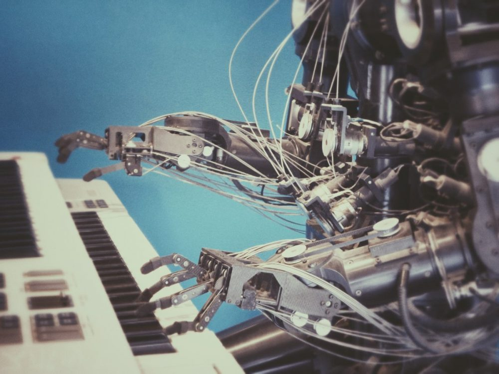 robot playing piano